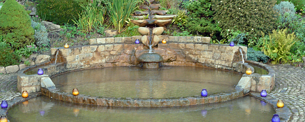 Vesica Pisces Pool in the Chalice Well Peace gardens in Glastonbury